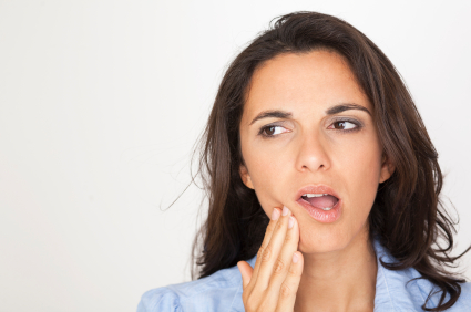 A women suffering from pericoronitis causing her pain!