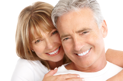 Mature couple smiling with arms holding each other